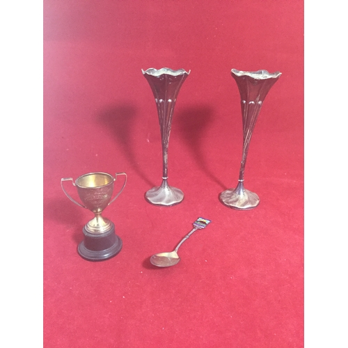 19 - A pair of filled silver bud vases,  together with a small silver trophy cup and a silver and enamel ...