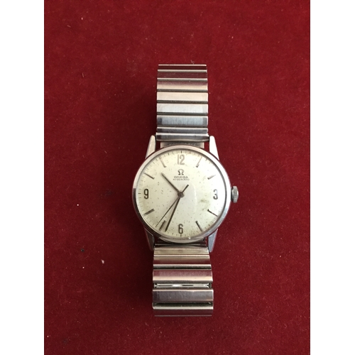 41 - A gent's Omega automatic steel cased wristwatch,  with signed circular dial and bracelet strap -...