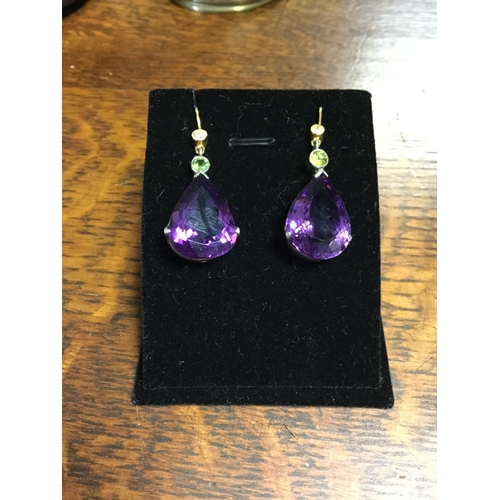 43 - A pair of diamond, peridot and amethyst ear-pendants,  with gold mounts, the collet set diamond surm...