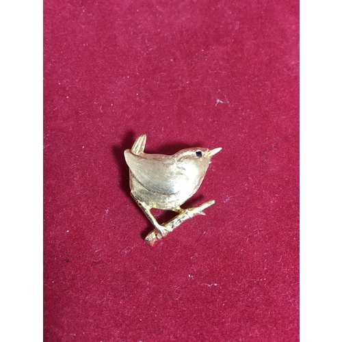50 - A pretty 9ct gold brooch,  modelled as a wren on a branch, with sapphire set eye -...