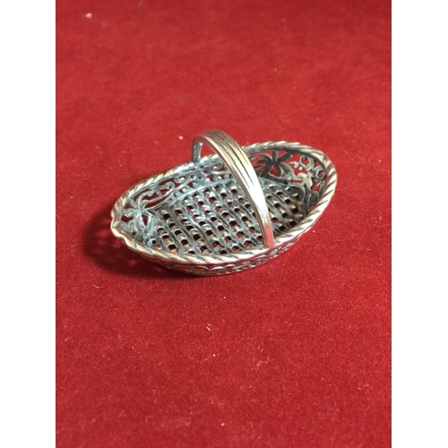 20 - A miniature white metal basket,  with floral detail and faux woven base -...