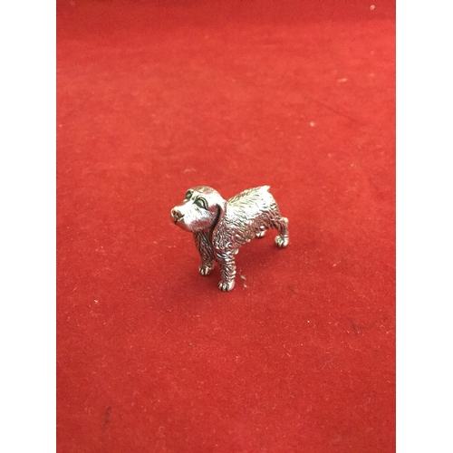 6 - A silver model of a standing dog, stamped Sterling -...