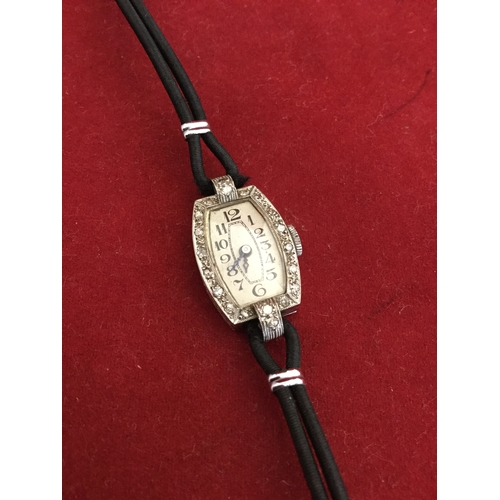 23 - An early 20th century platinum and diamond set cocktail watch, the tonneau shaped case stamped plati...