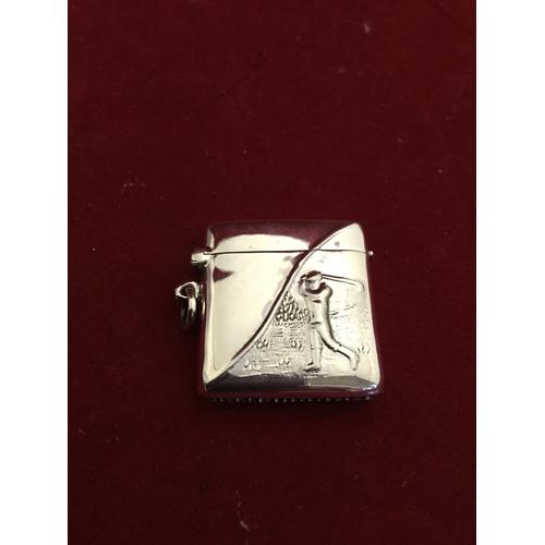 29 - A modern silver vesta, stamped sterling,  with golfing decoration -...