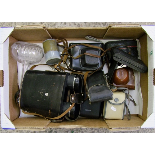 18 - A mixed collection of items to include: Zenit 35mm camera, Ensign and Kodak branded similar items to...