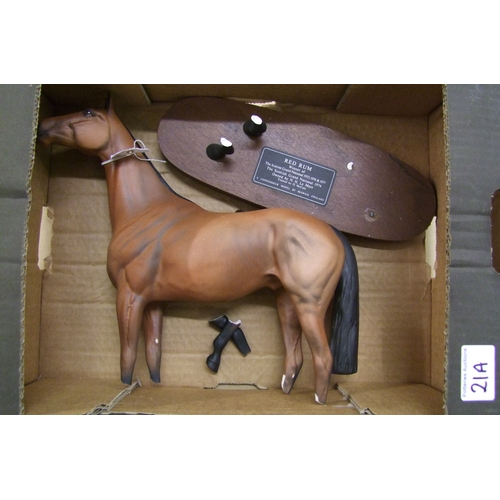21A - Beswick Red Rum on wooden plinth (damaged)...