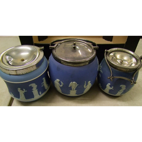 27 - A collection of Wedgwood jasper ware: to include two biscuit barrels ( 1 chip to base rim) and a met...