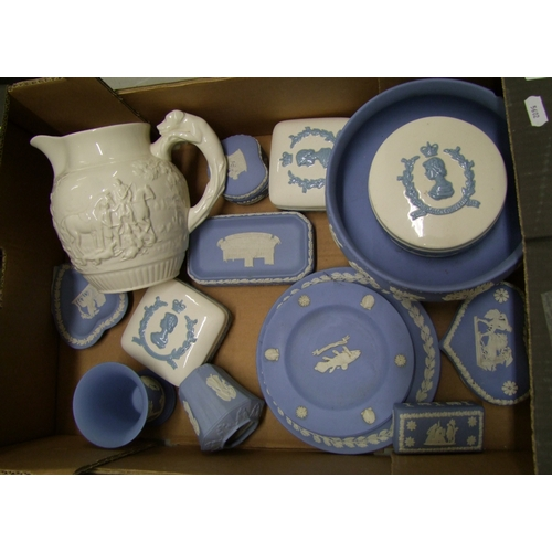 31 - A collection of Wedgwood jasper ware: to include plates, footed bowl ( chip to rim), vases, lidded b...