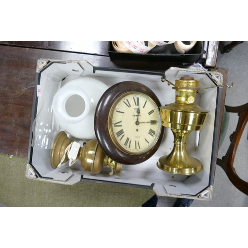16 - A brass oil lamp with shade: together with a Smith empire wall clock and oil lamp base...