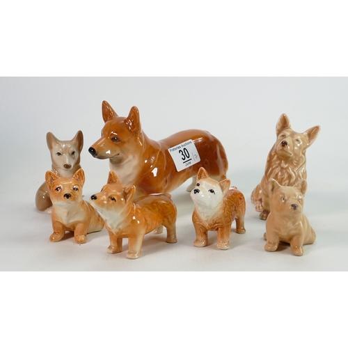30 - A collection of 7 Sylvac & Similar Corgi Dog figures: tallest 12cm(7)