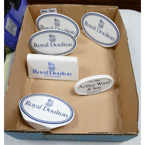 48a - A collection of Royal Doulton Arthur Woods Ceramic Counter Top Advertising Name Plaques(6)