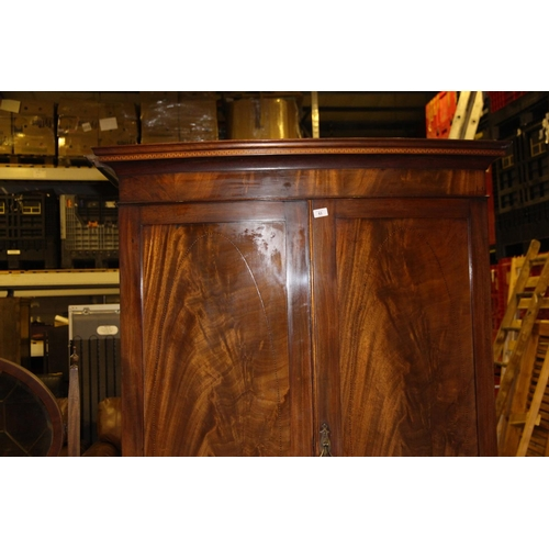 53 - Large bow fronted Victorian flame mahogany wardrobe with 2 drawers beneath...