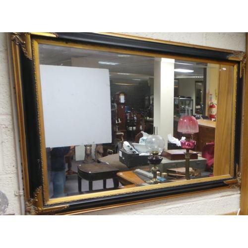 39 - Brass Bound Black and Gilt Wall Mirror...