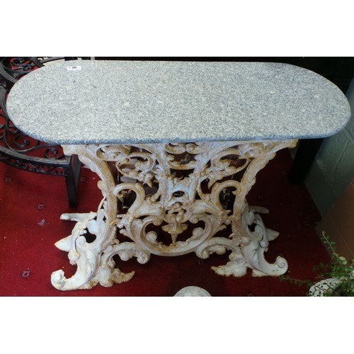 19 - Marble topped garden table...