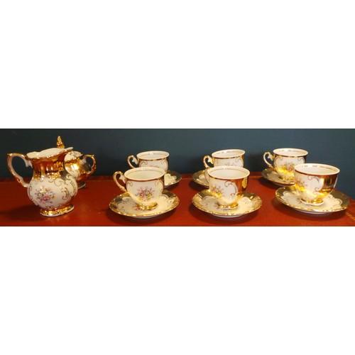38 - Tea Set with Six Cups and Six Saucers...
