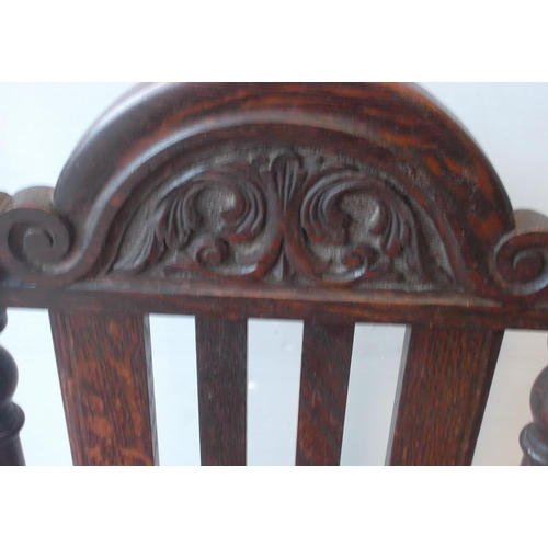 23 - Carved Oak Hallchair with rattan seat...