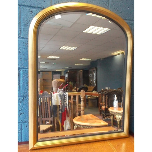25 - Gilt Arched Overmantle Mirror, 113cm high x 88cm wide...