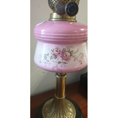 2 - Early 20th Century Double Burner Oil Lamp having cranberry glass shade, clean glass chimney above a ...