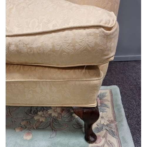 35 - Upholstered Wing Back Armchair on cabriole legs
