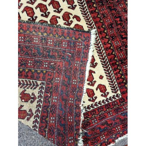 41 - Red and Cream Wool Carpet 100cm x 190cm