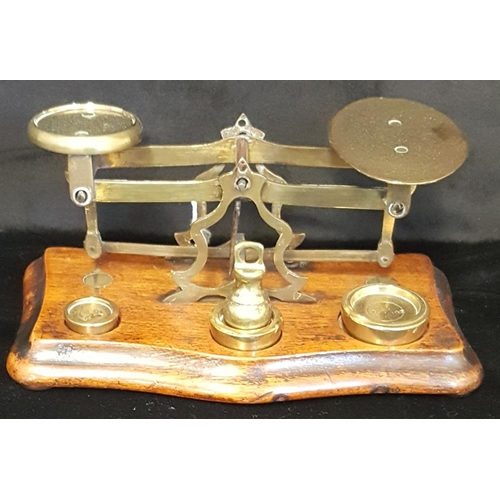 256 - LETTER SCALE 19thC small size brass letter scale with oval shaped platform on hardwood base with fou...