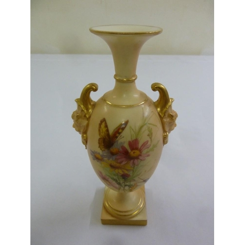 105 - Royal Worcester blush ivory porcelain vase decorated with butterflies, flowers and leaves and mask s...