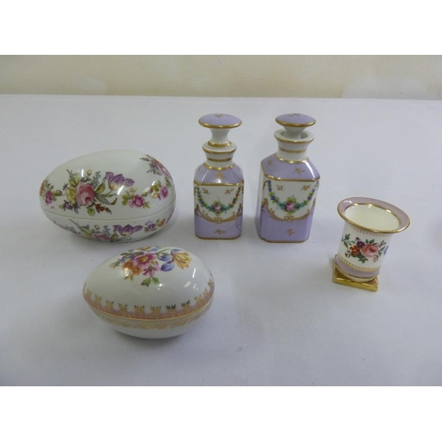 124 - A quantity of porcelain to include Limoges perfume bottles, a Halcyon Days vase and two German hand ...