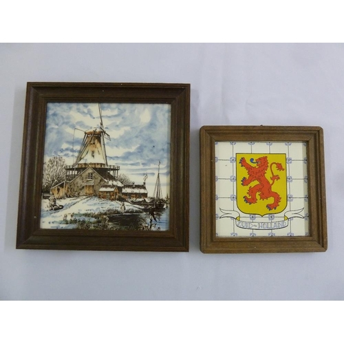 129 - Two framed hand painted porcelain tiles...