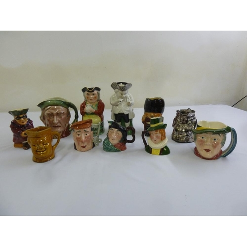 131 - A quantity of Toby and character jugs  (11)...