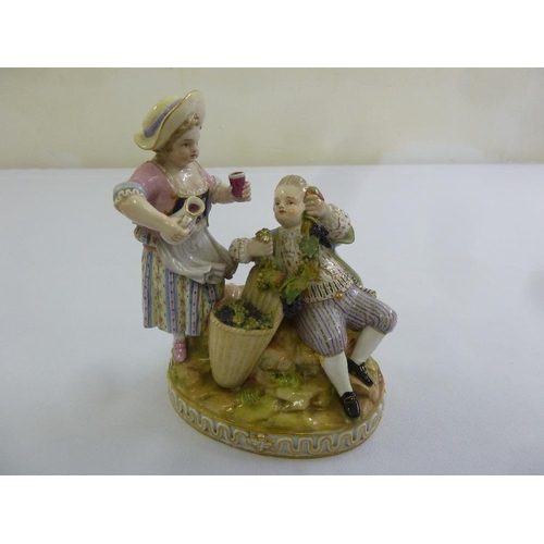 133 - Meissen a figural group of grape pickers on raised circular base, marks to the base, 17cm (h)...