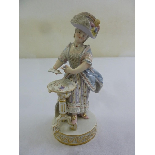 134 - Meissen figurine of a lady in classical dress playing cards, marks to the base...