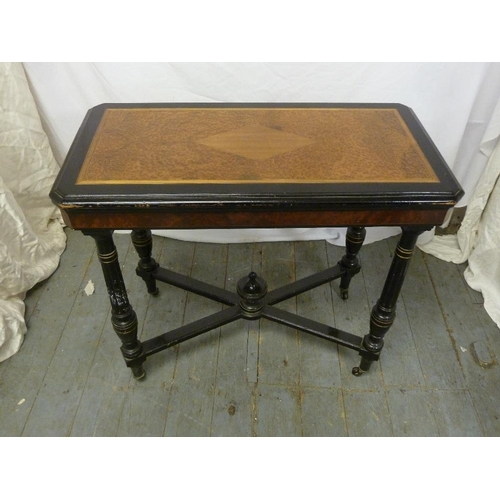 14 - A Victorian rectangular card table on four turned legs with burr walnut insert to the top...