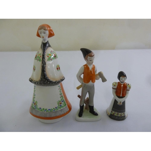 143 - Three Hungarian porcelain figurines in traditional costume...