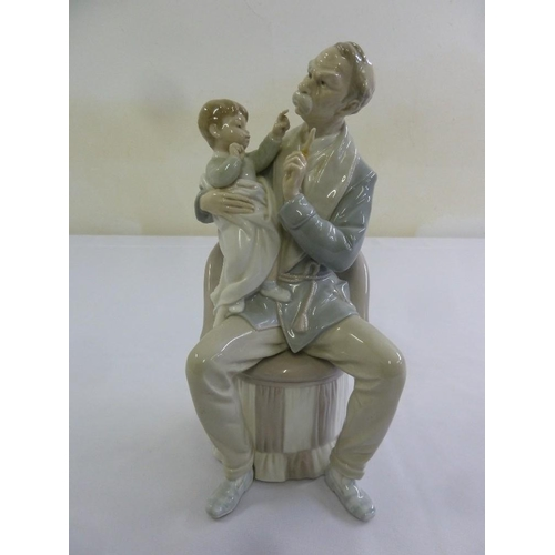145 - Lladro figurine of Grandfather and baby, A/F, 30.5cm (h)...