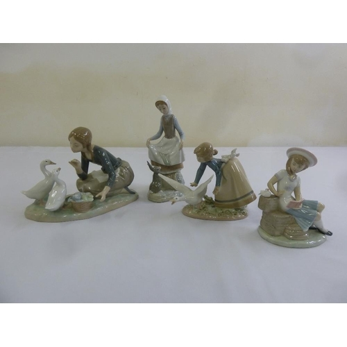 146 - Four Lladro figurines to include model numbers 4849, 4826, 5553 and 6024...