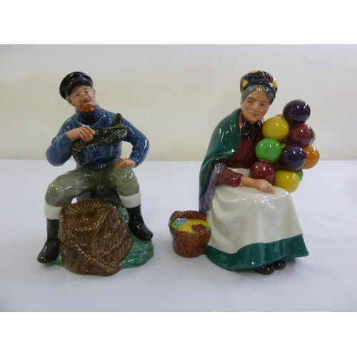 147 - Royal Doulton figurines, The Lobster Man HN2317 and The Old Balloon Seller HN1315...