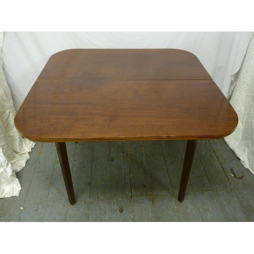 15 - An Edwardian mahogany games table on tapering rectangular legs...