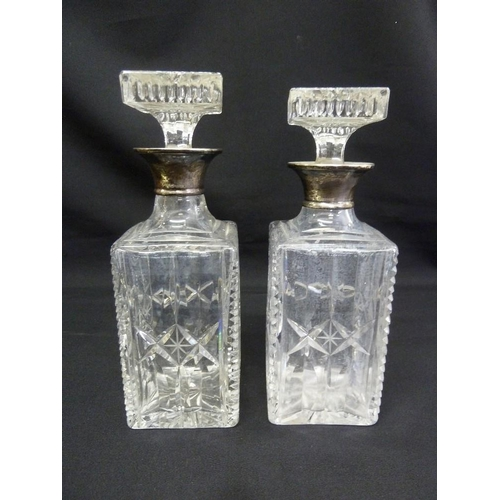 159 - Two cut glass decanters with drop stoppers and silver collars...