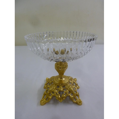 163 - A gilt metal and glass table centre piece on raised scroll pierced base...