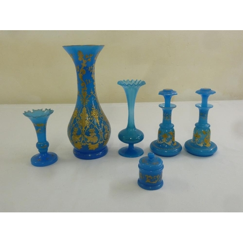 166 - A quantity of Victorian gilt decorated blue glass ware (6)...