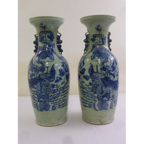 171 - A pair of Chinese 19th century celadon glazed baluster vases with blue and white stylised dragon and...