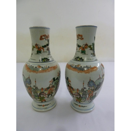 172 - A pair of Kangxi famile verte vases decorated with figures in an idealised landscape, 28.5cm (h)...