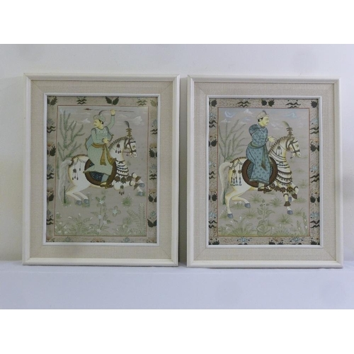 186 - A pair of Persian framed and glazed silk paintings of figures on horseback, 49 x 37cm...