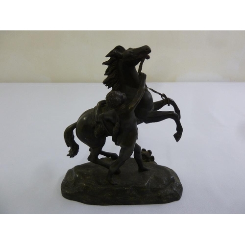 188 - A bronze of a Marly horse and tamer in the style of Coustou, 18cm (h)...