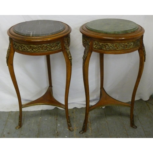 19 - Two Continental mahogany circular side tables with gilded metal mounts and detachable marble tops...