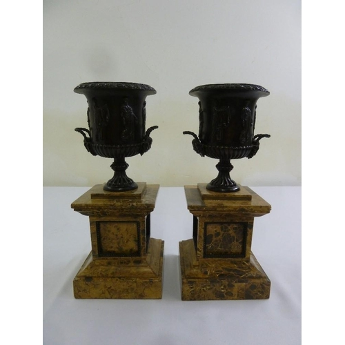 191 - A pair of bronzed classical style urns on faux Sienna marble plinths, 36cm (h)...