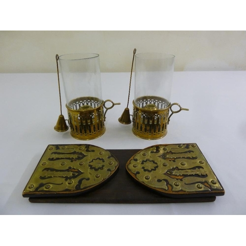 195 - A pair of brass and glass storm lanterns with candle snuffers and a brass and wood bookstand...