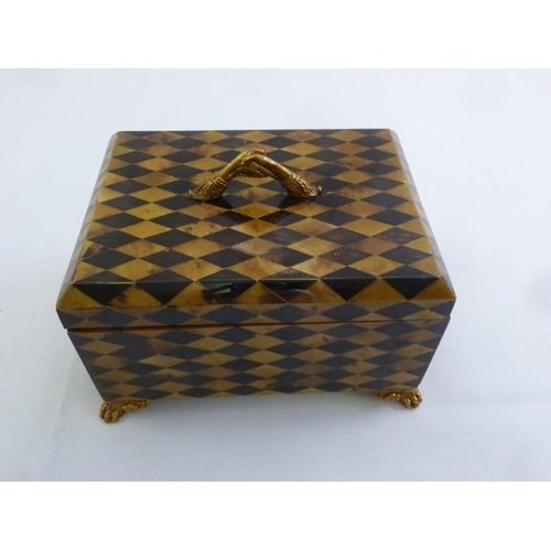 200 - Maitland and Smith rectangular parquetry box with brass handle on four claw feet...