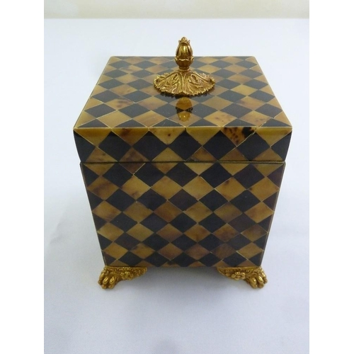 201 - Maitland and Smith square parquetry box with brass bud finial to the cover on four claw feet...