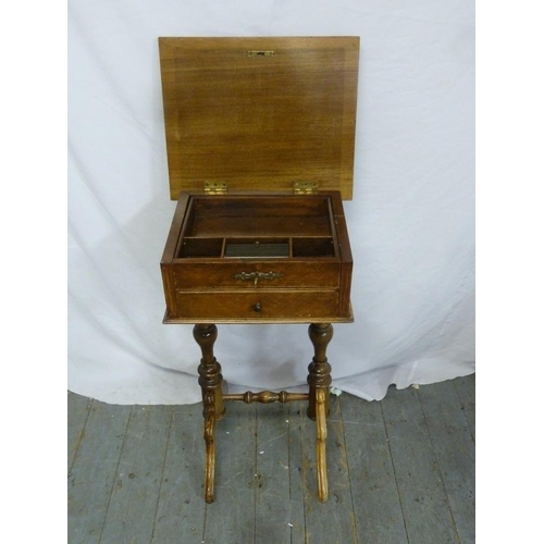 21 - A Victorian mahogany sewing table rectangular with two drawers and hinged top on turned scroll stand...